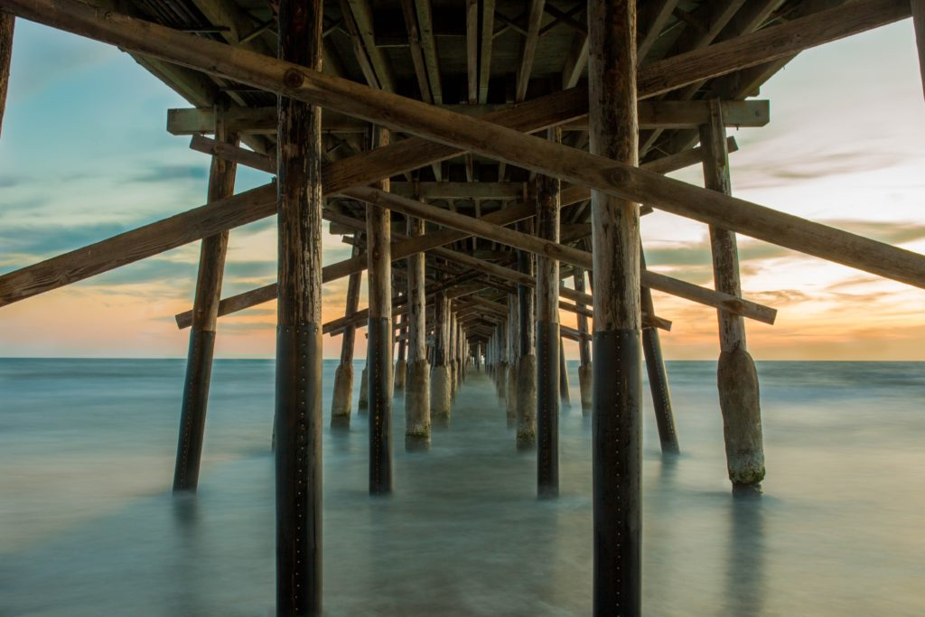 legs of pier in water